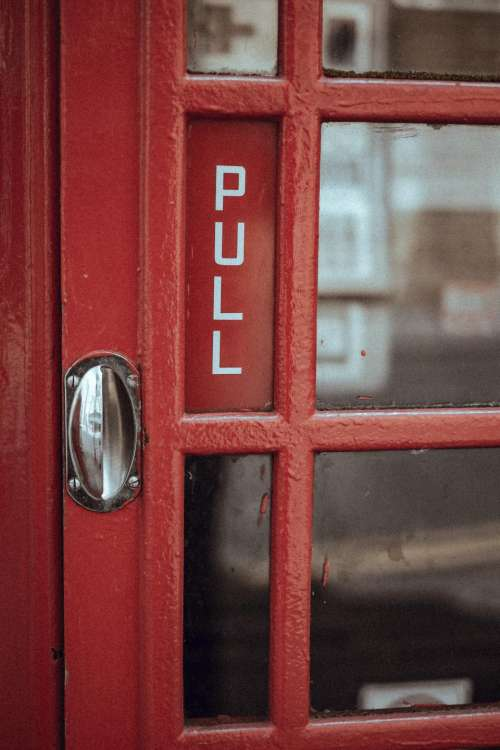 red door telephone booth payphone