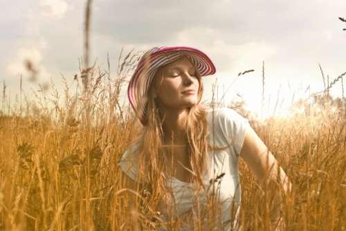 woman sun hat field farm
