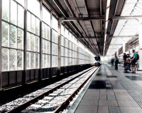 train station black and white railway track