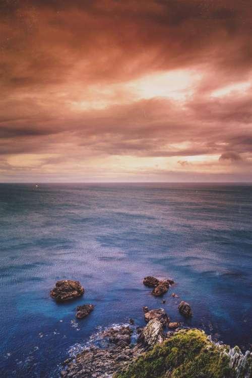 sunset sky clouds horizon ocean