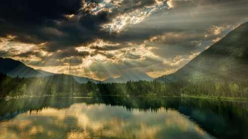 sunlight clouds lake water river