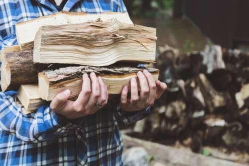 firewood man woodpile flannel shirt