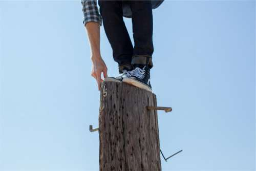 wood post climbing shoes jeans