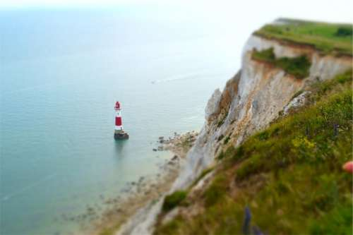lighthouse coast ocean sea water