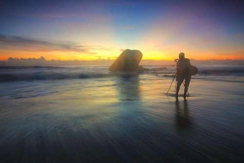 sea water mountain rock sunset