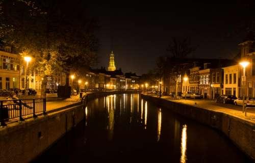 dark night city canal buildings