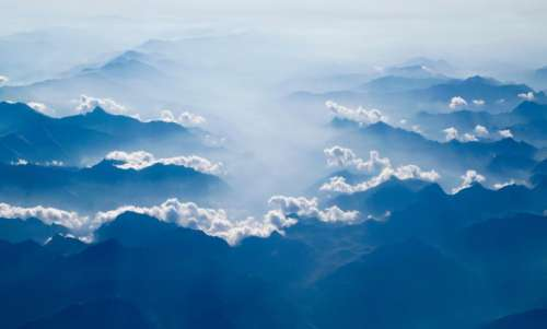 snow mountain clouds aerial blue
