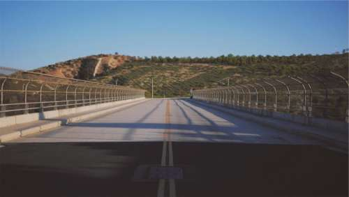 road pavement overpass chainlink fence