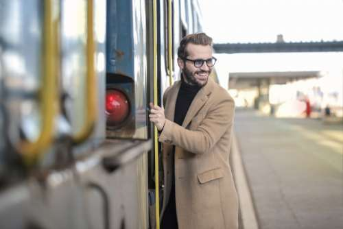 man entering train business smile