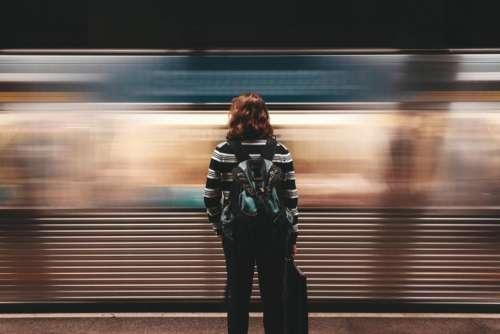people woman wait train station