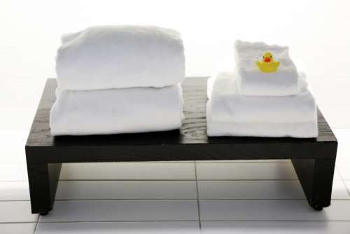 spa white towels tiles bench