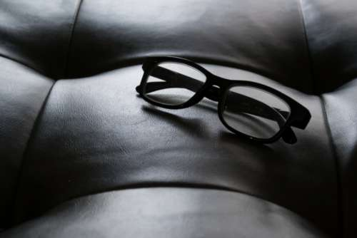 designer glasses background object sunlight