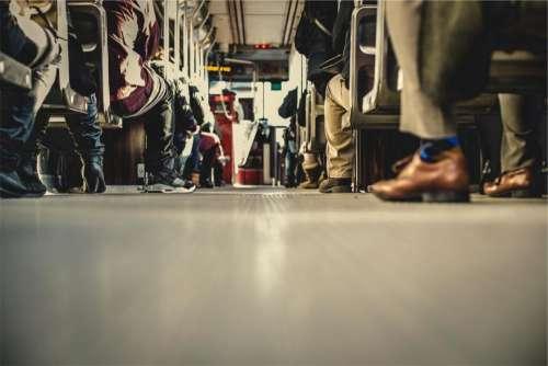 bus transportation people aisle shoes