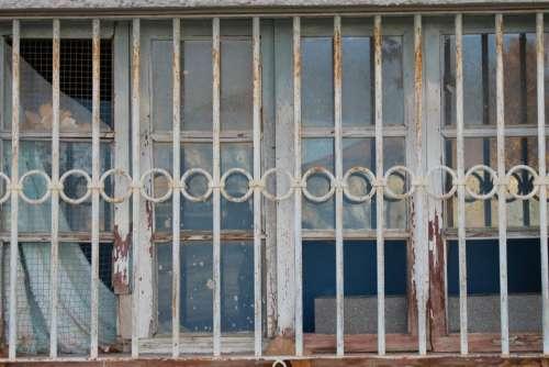 house outside window rusty steel