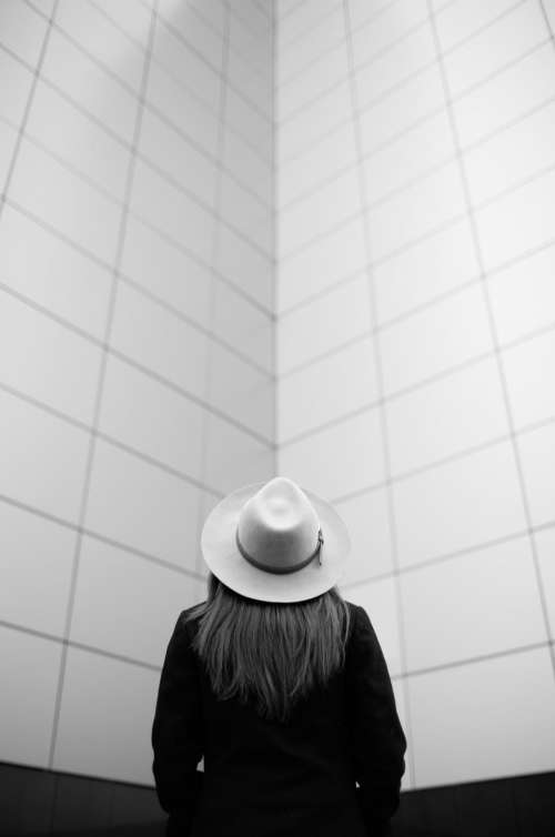 black and white people girl hat alone