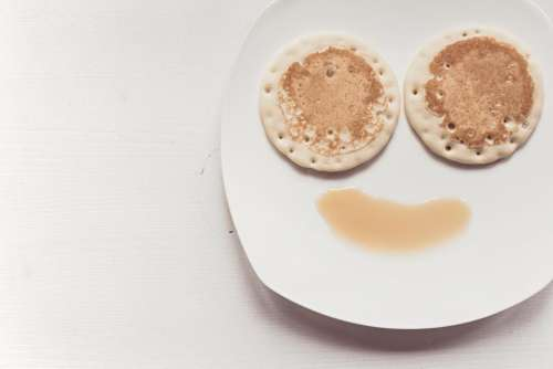 breakfast food pancakes maple syrup smiley face
