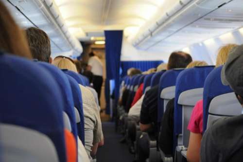 airplane on board seats people travel