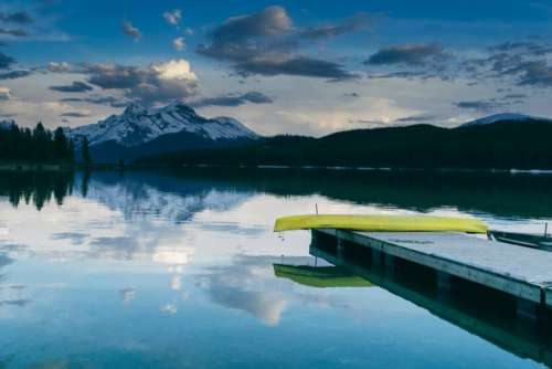 lake water dock canoe reflection