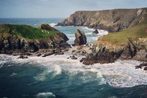 cliff rocks hill sea blue