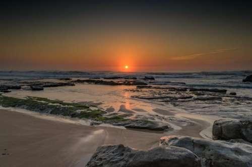 sunset dusk beach sand ocean