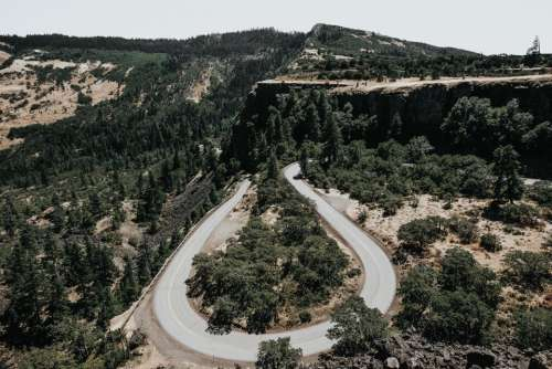 hairpin winding road highway trees