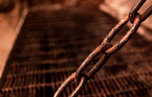 rusty chain link grate steel