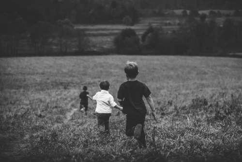 kids children boys playing running