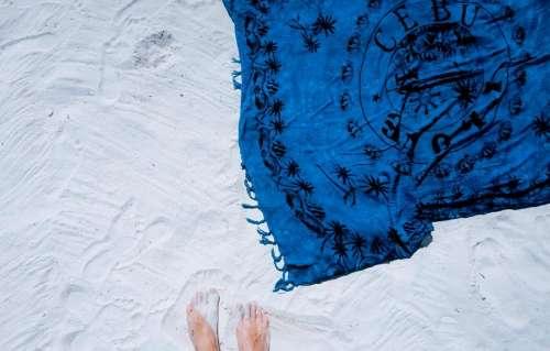 white sand beach blue shawl