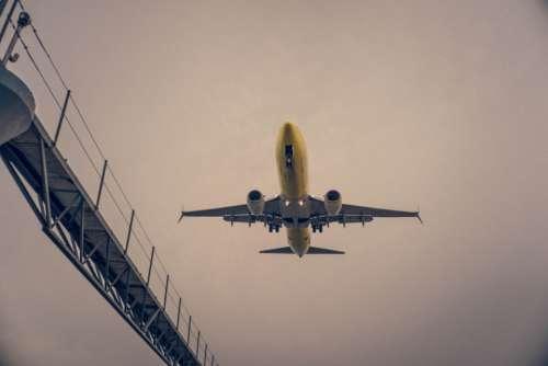 plane flying overhead cloudy sky