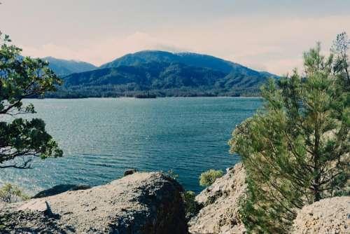 landscape lake water rocks mountains