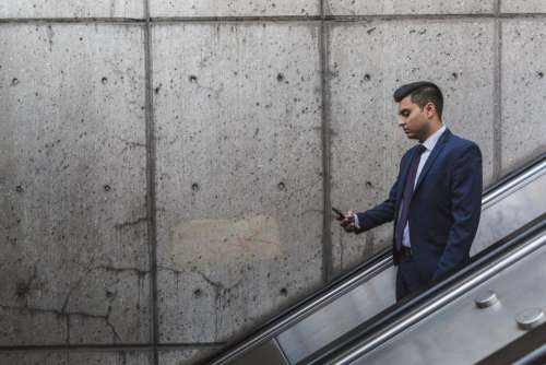 people business man formal escalator