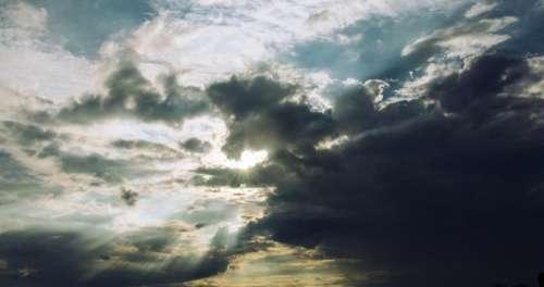 sunlight sunshine dark clouds sky