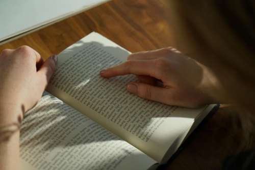 people hand point book reading