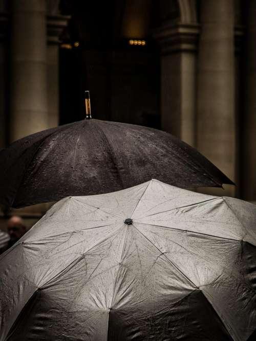 black umbrella water drops raining