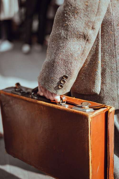 brown leather case bag people