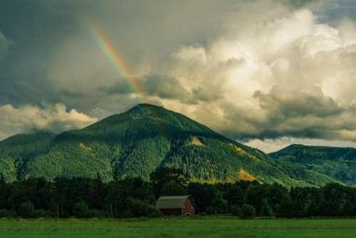 rainbow mountains hills green grass