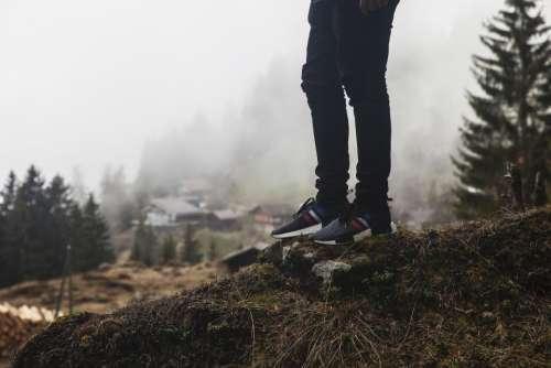 people man black shoes woods