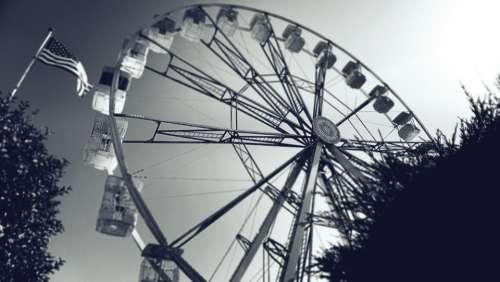 ferris wheel big wheel fairground rides flag