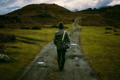 woman walking track mountain hill