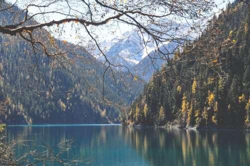 lake water mountains hills trees