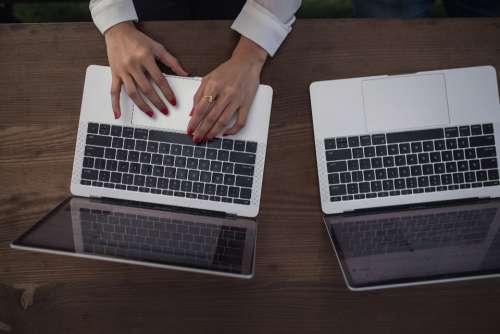 woman typing laptop aerial top