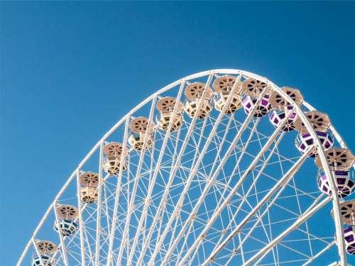 ferris wheel blue sky amusement park fair