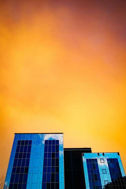 sunset dusk sky yellow buildings