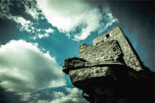castle wall stones rocks blue sky
