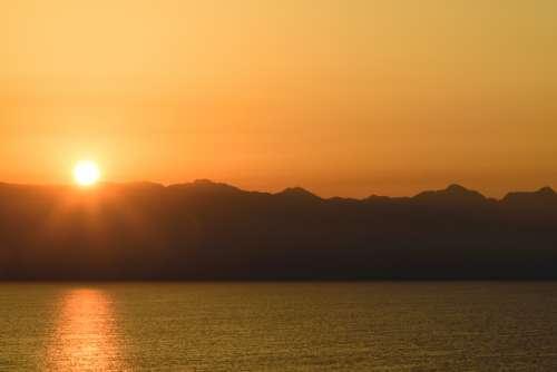 mountain water sunset warm orange