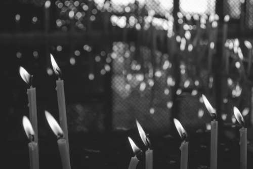 candles flames fire dark black and white