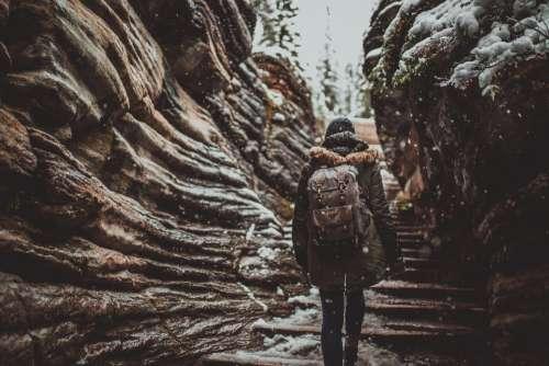 girl backpack photographer walking hiking