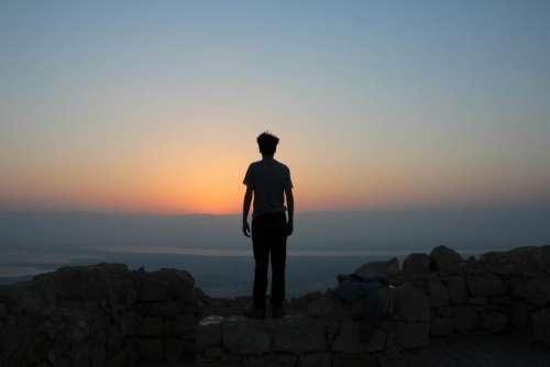 man guy adventure rock sunset