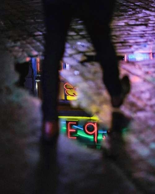 people walk dark night street