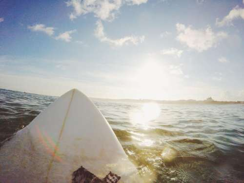 surfboard surfing ocean sea water
